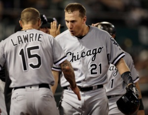 Chicago White Sox's Todd Frazier, right, celebrates with Brett Lawrie (15) after hitting a three-run home run off Oakland Athletics' Chris Bassitt during the fifth inning of a baseball game Tuesday, April 5, 2016, in Oakland, Calif. (AP Photo/Ben Margot)